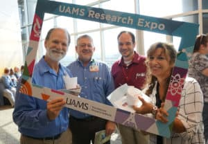 After making the rounds at the Expo, researchers enjoyed ice cream. (l-r) Kirk Smith, Phillip Farmer, Michael Rutherford and Debra Napoli.