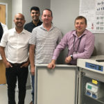 Scientists in lab with Emulate machine