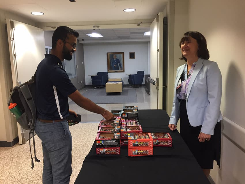 Medical student Dhruba Dasgupta receives a Kind bar from Stephanie Gardner, Senior Vice Chancellor for Academic Affairs & Provost, during Kindness Week.