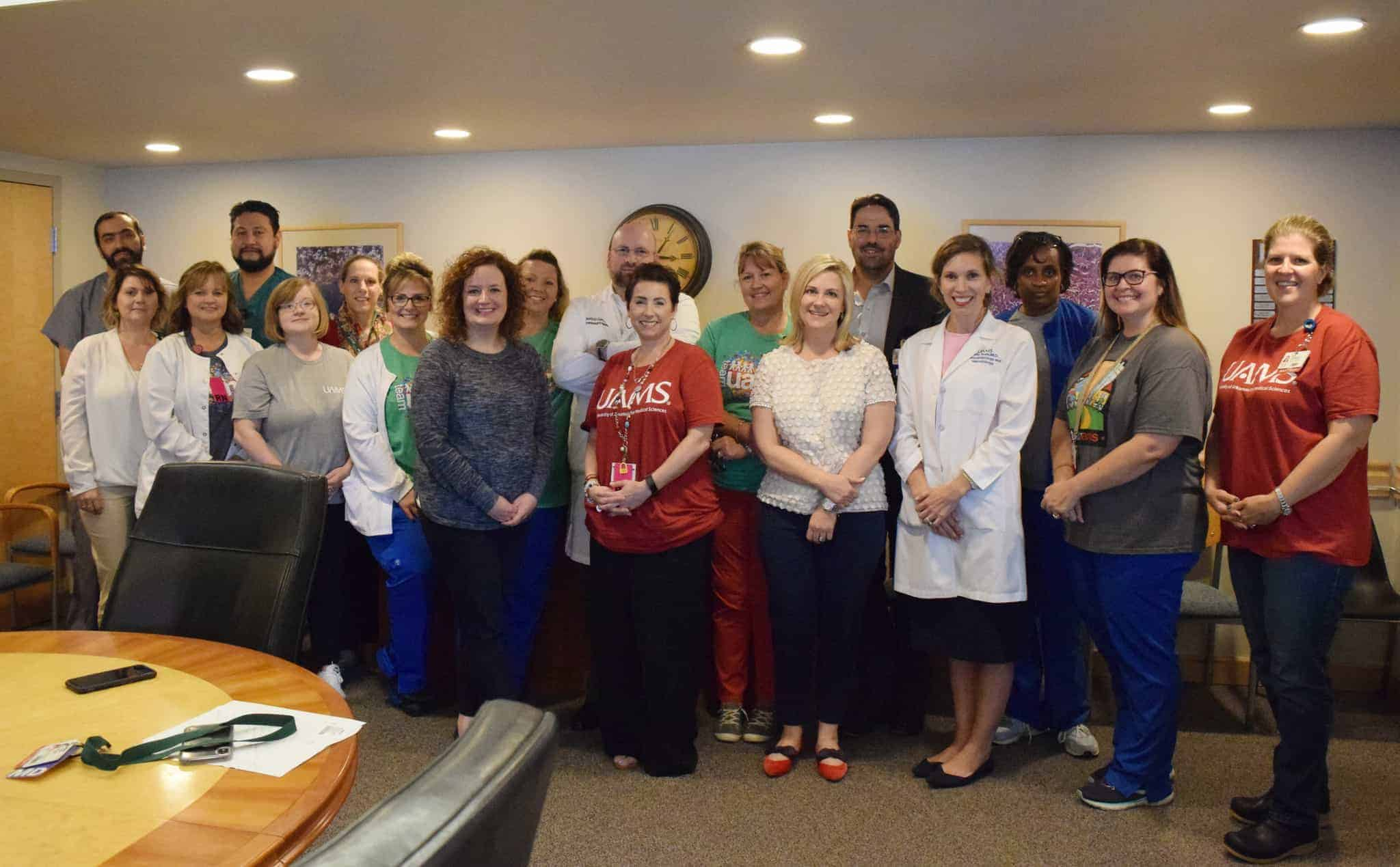 UAMS is home to the only liver transplant program in Arkansas. Pictured are (L-R front) Joy Cope, R.N.; Kim Gipson, B.S.N.; Leslie Kurczek, Pharm.D.; Brandi Barnhart, R.N.; Amanda Stevens, M.Sc.N., R.N.,; Stephanie Thomson; Holly Trotta, D.N.P., R.N.; Katie Rude, M.D.; Larissa Ivory, R.N.; Felicia Allard, M.D.; (L-R, back) Emmanouiil Giorgakis, M.D; Gerardo Tamayo-Enriquez, M.D.; Karen Johnson; Kelly Wilson; Mauricio Garcia, M.D.; Denice Roberts; Lyle Burdine, M.D.; and Kim Marcus.