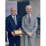 Drs. Mehta and Bolli standing together with plaque