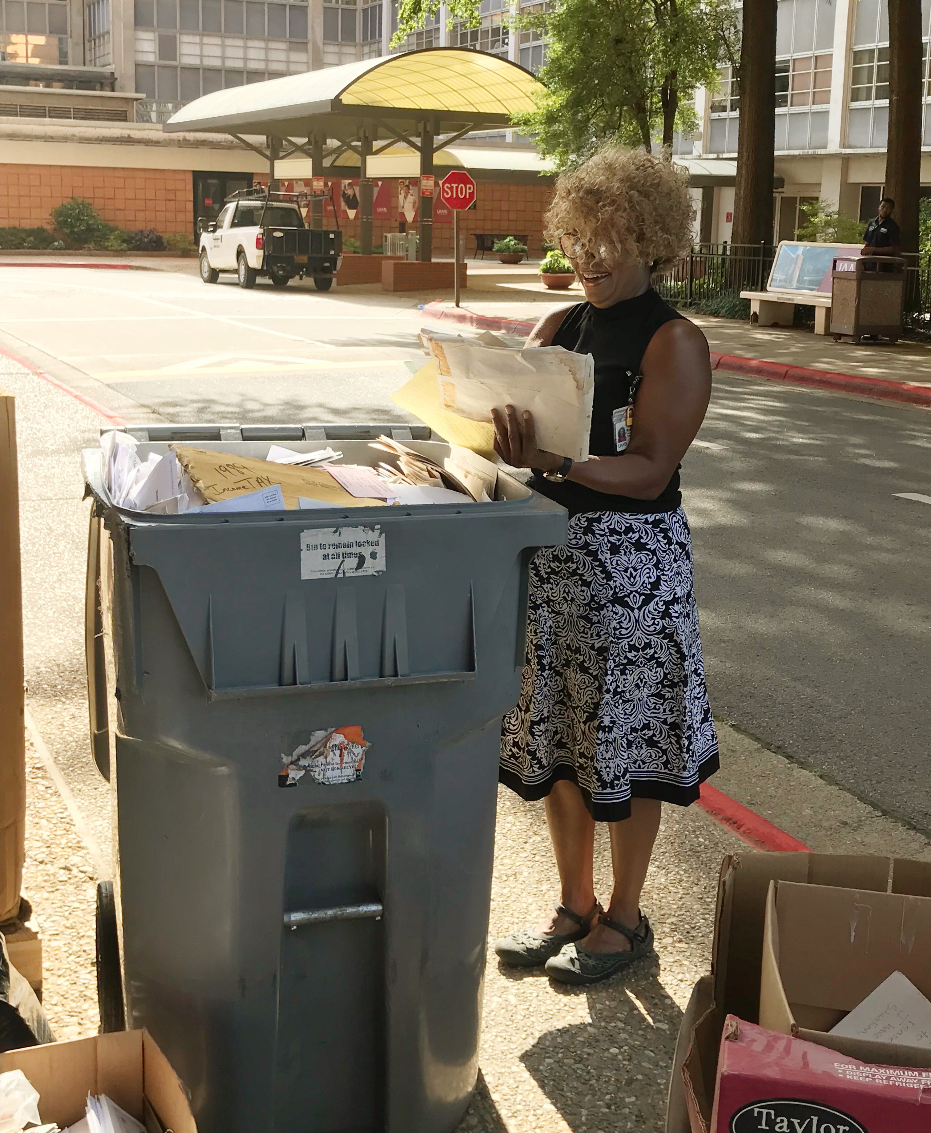 Tonya Robinson sorts paper for shredding and recycling during UAMS Recycling Day on Aug. 19.