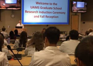 Robert McGehee, Jr., Ph.D., addresses the students, their instructors, relatives and friends during the annual research induction ceremony.