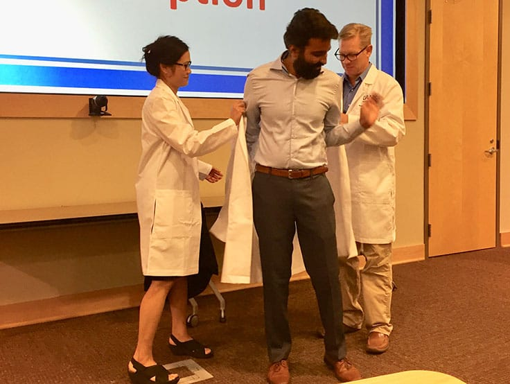 Twenty-five UAMS Graduate School students from seven programs received white lab coats Sept. 16, signaling their readiness to begin doctoral research.