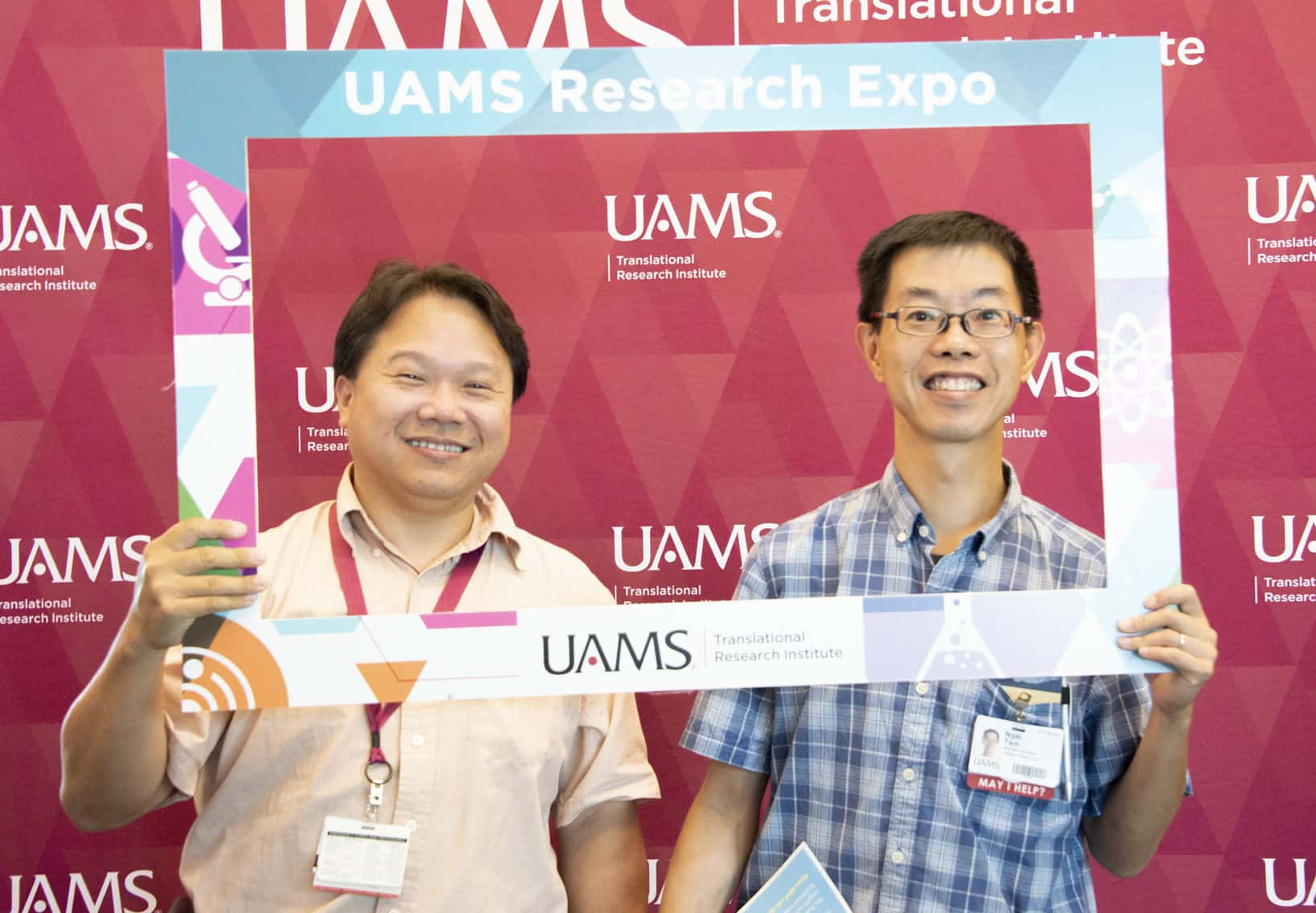 """Yuet-Kin """"Ricky"""" Leung, Ph.D., enjoyed the Research Expo with Nagai C. """"Neville"""" Tam, Ph.D."""