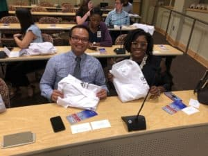 Ph.D. candidates Visanu Wanchai of Biomedical Informatics and Skylar A. Conner of Bioinformatics show off their research coats before donning them.