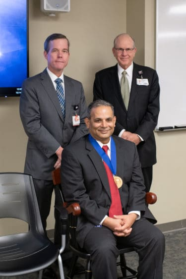 UAMS Chancellor Cam Patterson, M.D., MBA and UAMS College of Medicine Dean Christopher T. Westfall, M.D., FACS presented the chair and medallion to Choudhary.