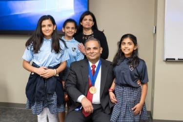 Choudhary with his wife, Bhawna Jha, M.D., and their children Rhea, Anya and Keya.
