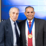 Ernest Ferris, M.D., longtime chair of the Department of Radiology and the chair's namesake, and Arabinda K. Choudhary, M.D., wearing the commemorative medallion.