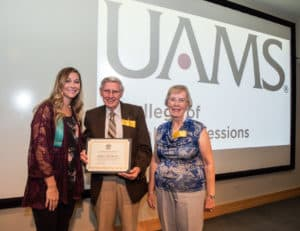 Scholarship recipient Kelsey Kitchens with James O. Wear, Ph.D., and his wife, Judy.