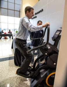 Chancellor Cam Patterson, M.D., MBA, tests drives an elliptical trainer at the Employee and Student Health Fair.