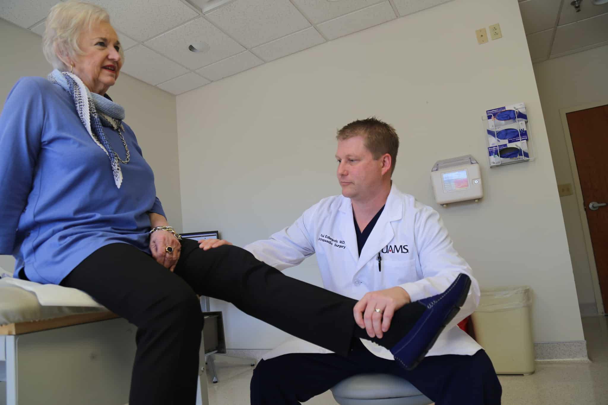 Paul Edwards, M.D., with total hip replacement patient Joan Baldridge.