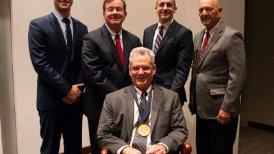 Smeltzer poses with (from left) Daniel G. Meeker, Ph.D.; C. Lowry Barnes, M.D.; James E. Cassat, M.D., Ph.D.; and John J. Iandolo, Ph.D.