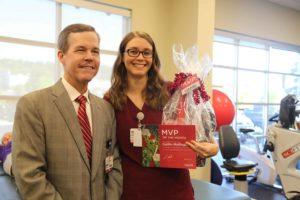 Chancellor Cam Patterson, M.D., MBA, recognizes October MVP Caitlin Mallinger.