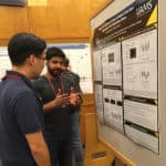 Maroof Zafar, center, discusses his research during a poster presentation at Cold Spring Harbor Laboratory.