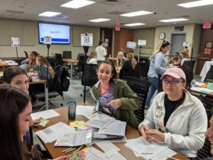 In May, participants took on the role of family members struggling with financial hardship during a pilot run of the poverty simulation.