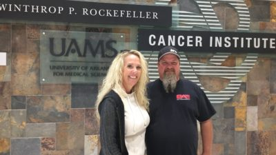 """I was determined to find the best place I could go for treatment,"" said drag racer and specialty mechanic Brian Macy, 49, of Lake Havasu City, Arizona, pictured here with wife Heather."