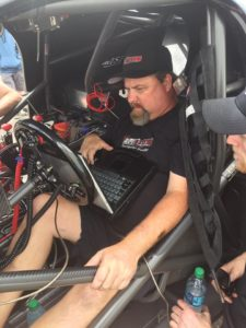 Brian Macy at work tuning a race car.