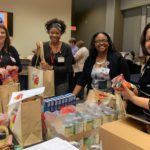 About 150 members of Team UAMS volunteered to build Thanksgiving bags for Stocked & Reddie, the UAMS food pantry.