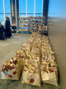 Volunteers filled and decorated 500 bags for Stocked & Reddie members.