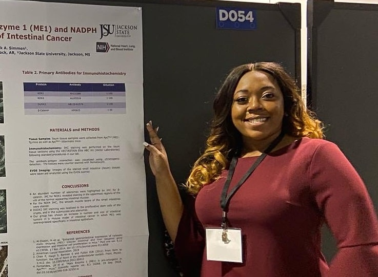Daija Green, a UAMS SRI participant from Jackson State University, with her research poster at ABRCMS 2019 in Anaheim, California.