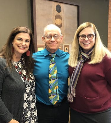 Amy Franks, left, and Dean Cindy Stowe, right, congratulate Dunn on his recent promotion to professor in the Department of Pharmacy Practice.