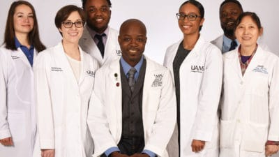 Antino Allen, seated center, leads one section of the College of Pharmacy's graduate program. Some of his students, left to right, are Madison Trujillo, Taylor McElroy, Tauren Brown, Pilar Simmons and Fabio Ntagwabira. Lab technician and research associate Jing Wang, M.D., Ph.D., is a research associate on Allen's research team.