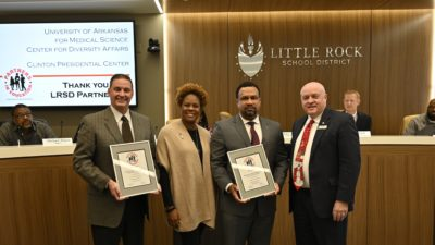 Hall High School Principal Mark Roberts, Ed.D., Kimberlyn Blann-Anderson and Brian Gittens, Ed.D., of the UAMS Division for Diversity, Equity and Inclusion, and Little Rock School District Superintendent Mike Poore.