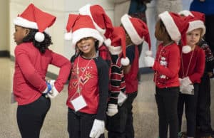Arriving at UAMS, the preschoolers were ready to begin sharing the seasonal songs with employees and visitors.