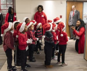 Sixteen preschoolers from Kennedy Head Start recently made stops at UAMS, caroling holiday tunes they'd learned.