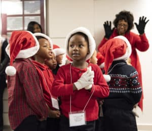 The group shared songs and gifts and, in return, each child went home with a clementine orange from Dr. Patterson.
