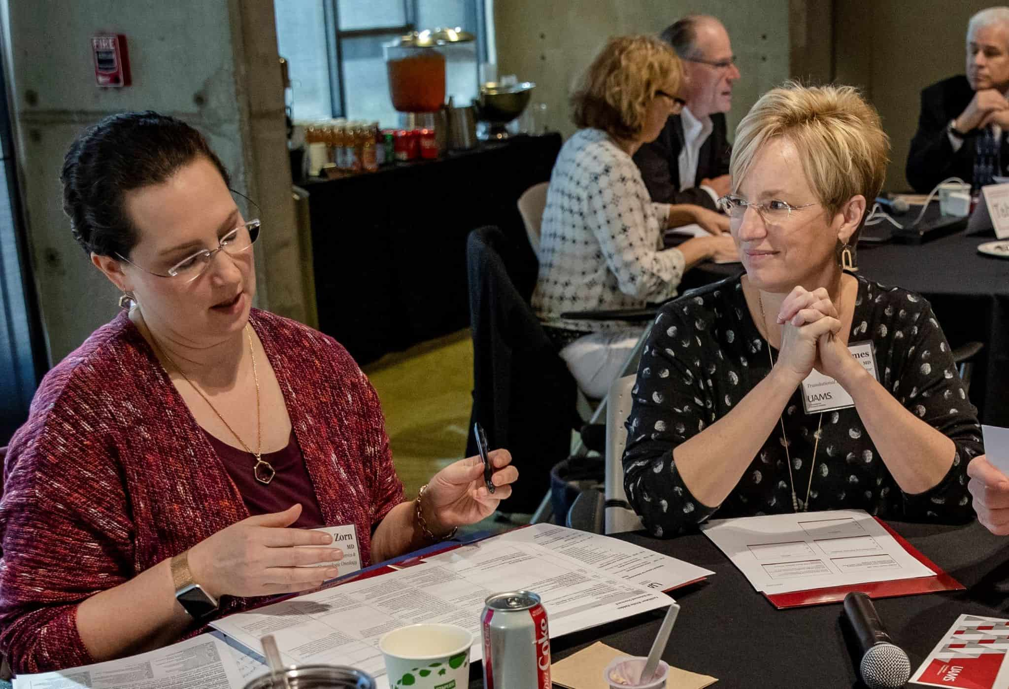 Laura James, M.D., right, with UAMS' Kristin Zorn, M.D., at a recent TRI Strategic Planning Retreat.