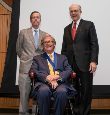 UAMS Chancellor Cam Patterson, M.D., MBA and College of Medicine Dean Christopher T. Westfall, M.D., presented Frazier with a commemorative medallion.
