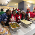 """Members of the Nutrition Services team smile as they get ready to serve thousands of their fellow employees. """"Throwing a party of this size is a massive undertaking, and there is no way we could have pulled it off without Tonya Johnson and her team from Nutrition Services,"""" said Annabeth Collier."""