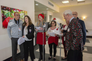 What holiday party is complete without carolers?