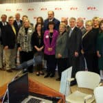 CEOs of Arkansas hospitals that are part of the Arkansas Rural Health Partnership, UAMS and Blue Cross and Blue Shield officials gather for a group photo after a news conference in Pine Bluff.