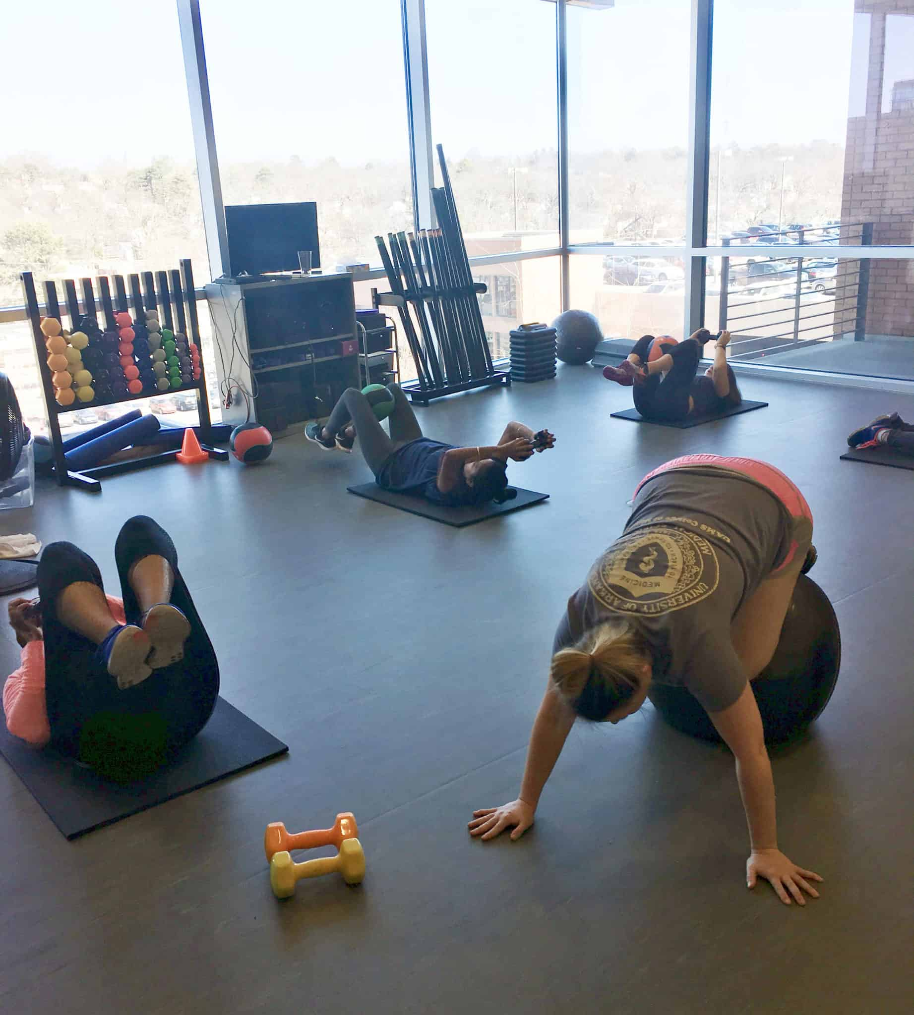 Team UAMS members work out in the Fitness Center. The 12x12 Challenge encourages participants to work out at least 12 times a month for an entire year.