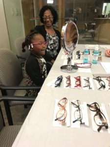 Harriett Smith smiles as her granddaughter tries on frames she's chosen for her new glasses.