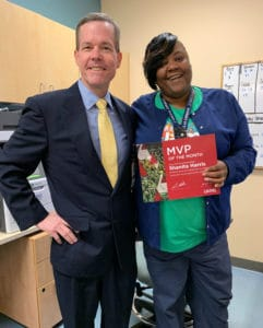 Chancellor Cam Patterson, M.D., MBA, presents Shanita Harris with the January MVP award.