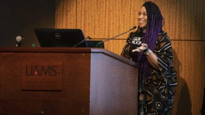 Guest speaker Crystal C. Mercer speaks about public service during the UAMS Martin Luther King Jr. Day Celebration.