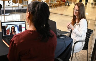 Stacy Petty, APRN, right, demonstrates the live, patient-to-provider video connection that is a central feature of UAMS HealthNow.
