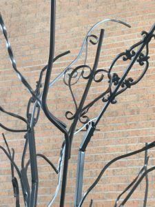 Look closely at the tree and you'll see decorative elements, such as these hearts, that were part of the original wrought iron.