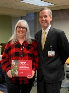 Chancellor Cam Patterson, M.D., MBA, presents the February MVP Award to Penny Talbert.
