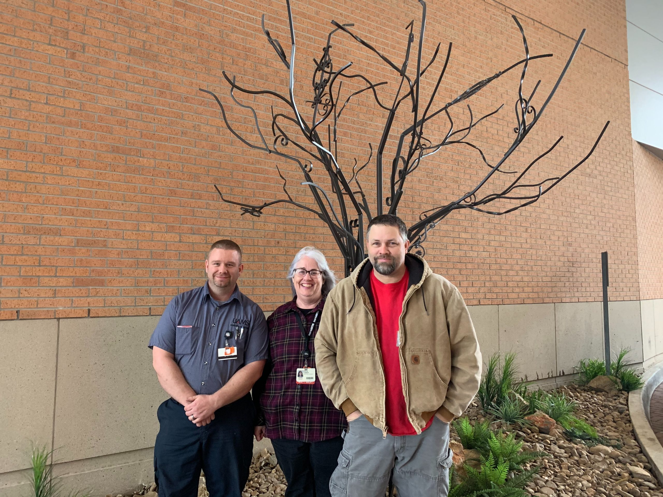 Eric Hale, Penny Talbert and Kenneth Bailey created this tree sculpture from wrought iron saved from the homes along Pine and Cedar.