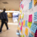 Kindness Walls scattered around campus urged employees to take a positive note and leave one in its place.