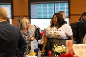 Presenter Tiffany Haynes, Ph.D., (right) talks to a TEDx talk attendee during a break.