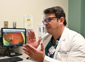"Sallam explains ""floaters"" with an image illustrating them in Winter's right eye prior to surgery."