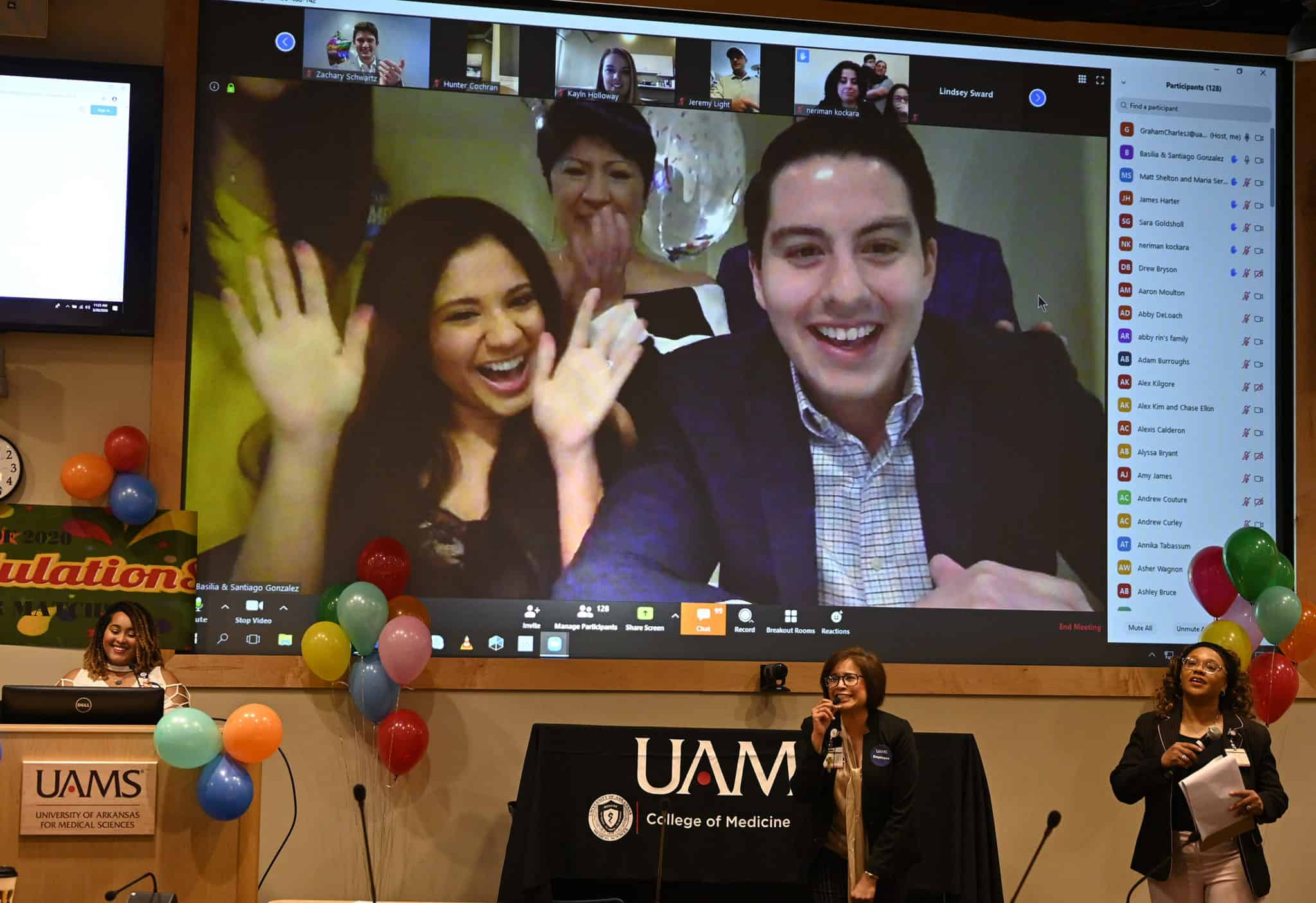 Students on screen with Dr. Tariq in foreground