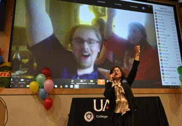 Student on screen with Dr. Tariq in foreground