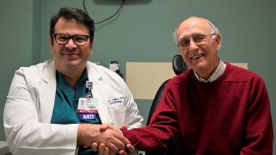 Ahmed Sallam, M.D., Ph.D., and patient Jim Winter.